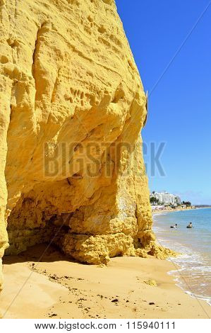 Children enjoying sunny weather on Armacao De Pera Beach on the Algarve coast
