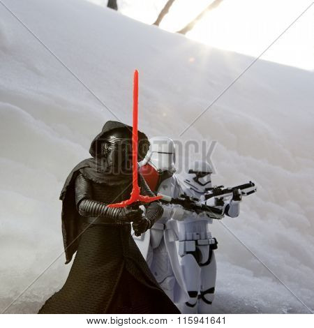 BLOOMFIELD NJ - JAN 24 2016: Kylo Ren and stormtrooper action figures recreate a winter scene from Starkiller Base from Star Wars: The Force Awakens. Lens Flare effect.