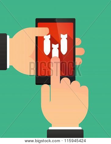 Hands Using A Phone Showing Three Bombs Falling