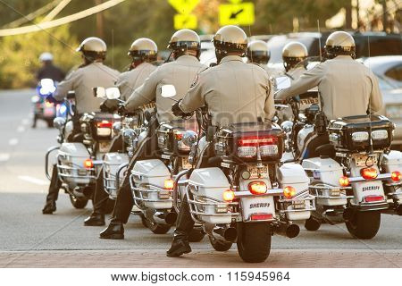Local Motorcycle Cops Ride Through Town At Georgia Festival