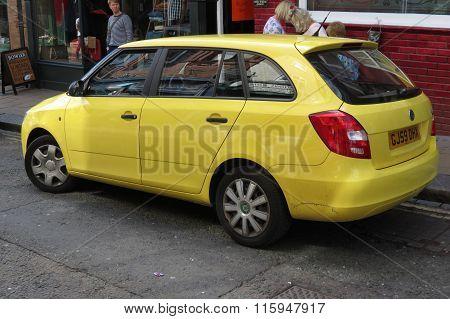 Yellow Skoda Fabia Car