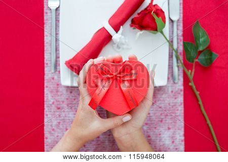 Woman Hands Holding Heart-shaped Present Box