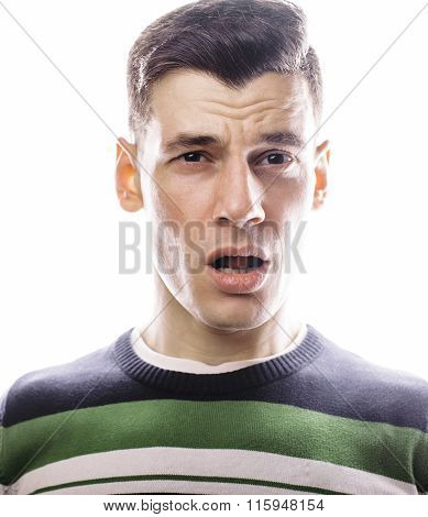 Portrait of a smart serious young man standing against white background. Emotional concept for gestu