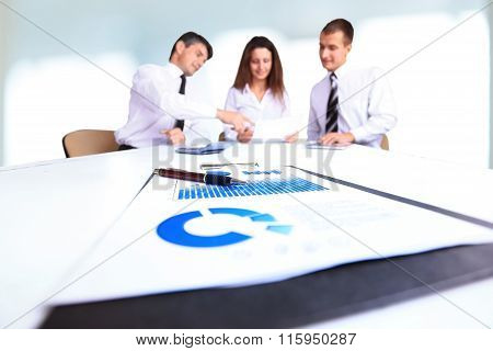 A Group Of Successful Businessmen. Discussion Of Charts And Graphs Of The Enterprise.