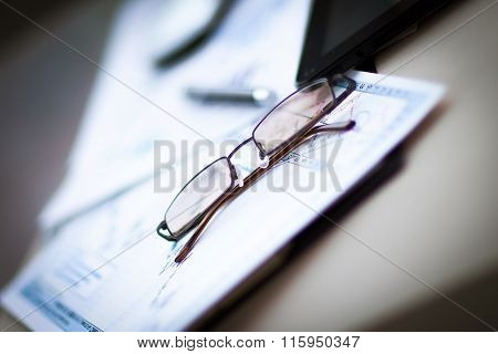 a signed contract and glasses in the workplace businessman