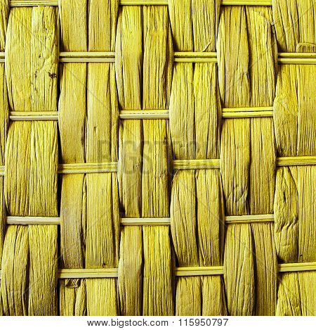 Imaginative Yellow Woven Reed / Wood Abstract Background Texture.