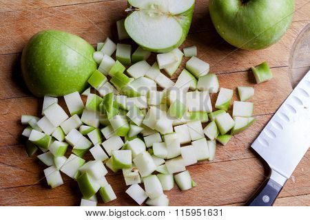 Cut green apples from above with knife