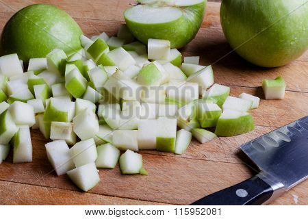 Cut green apples from side with knife