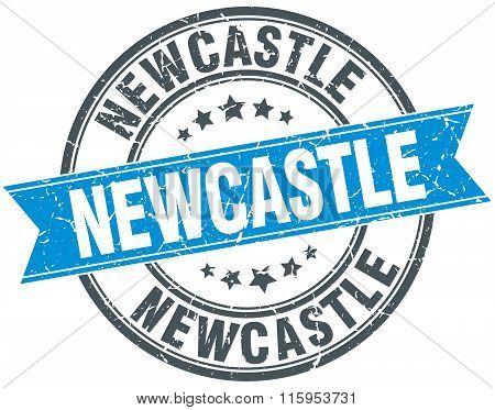 Newcastle blue round grunge vintage ribbon stamp