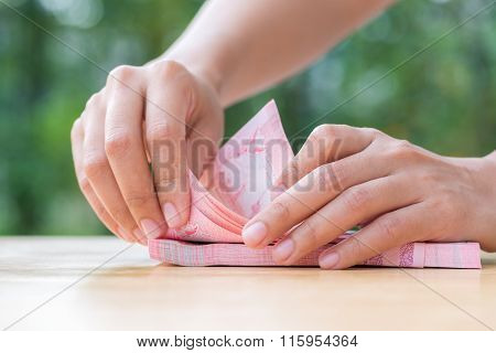 Woman Hand Counting Thai Cash On Wood Table