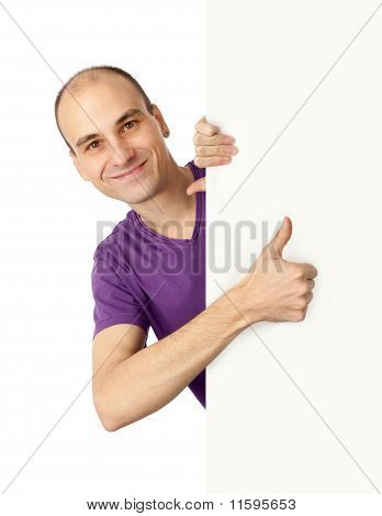 Man Holding A Vertical Billboard