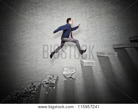 businessman jump over broken step