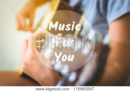 Text background music for you on a woman playing guitar.