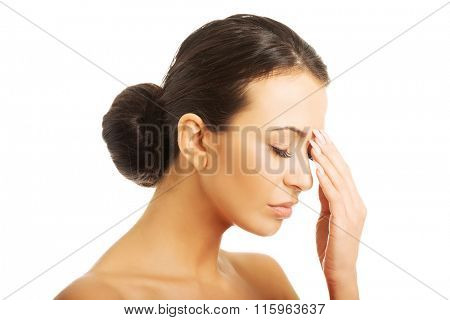 Stressed woman with eyes closed