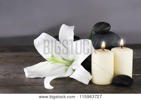 Spa still life with beautiful flower and candlelight on wooden table closeup