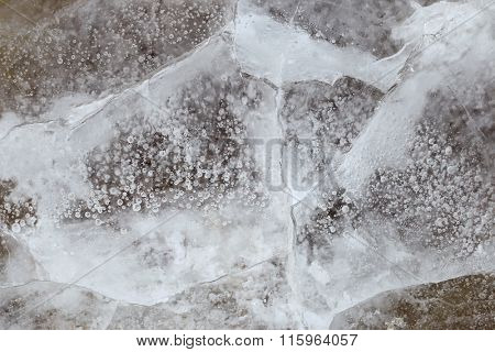 texture of Ice, background of scratches, bubbles, and cracks on the surface of frozen water