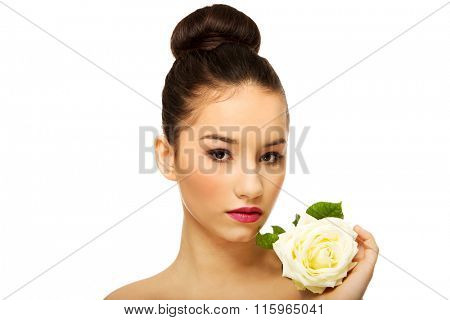 Beautiful woman with white rose.