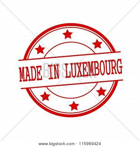 Made In Luxembourg Red Stamp Text On Red Circle On A White Background And Star