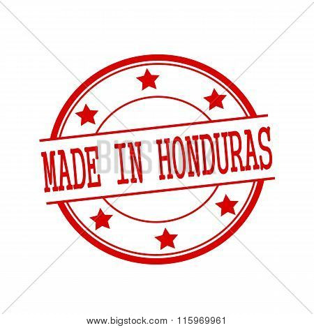 Made In Honduras Red Stamp Text On Red Circle On A White Background And Star