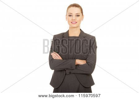 Happy businesswoman with crossed arms.