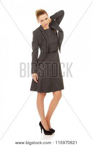 Businesswoman having neck pain.
