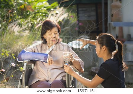 Young Asian Is Taking Care Senior Woman