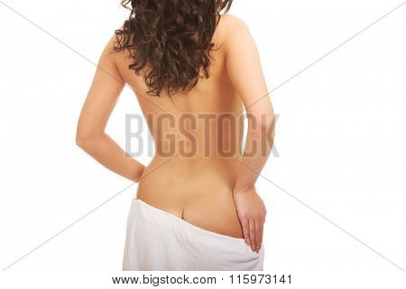 Young woman wrapped in towel.