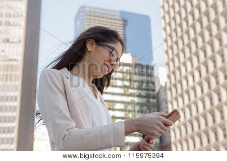 Young Latin Professional Woman With Glasses In The City