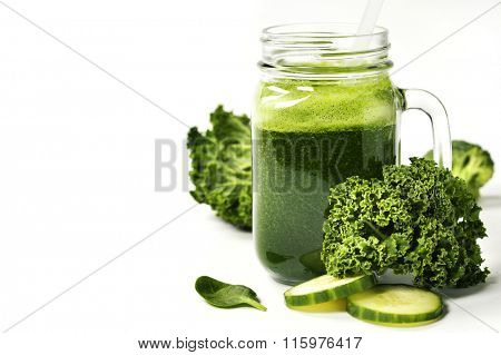 Healthy green smoothie and ingredients on white  - superfoods, detox, diet, health, vegetarian food concept. Background layout with free text space.