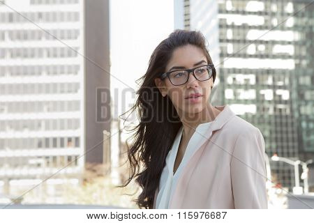Young Hispanic Professional Woman With Glasses In The City