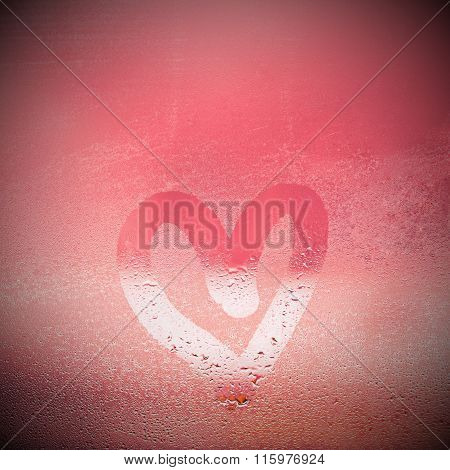 Painted heart on the foggy window.I love you written on condensation glass.