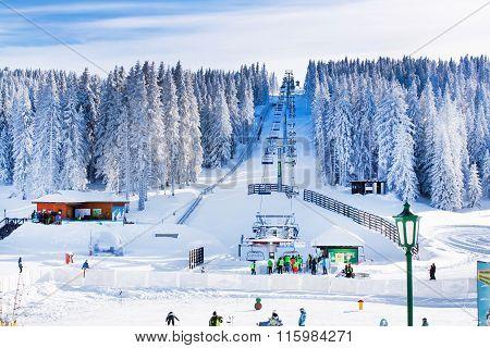 Panorama of ski resort Kopaonik, Serbia, skiers, lift, mountains