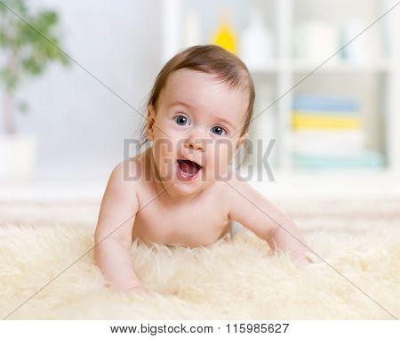 baby girl lying on belly