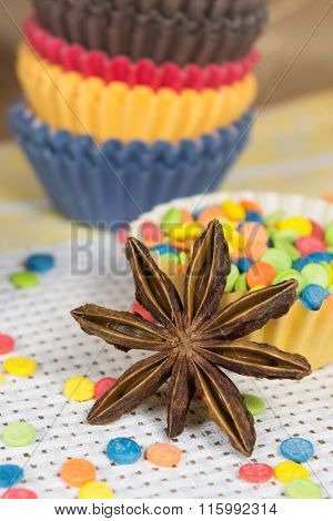 Star anise and dessert topping