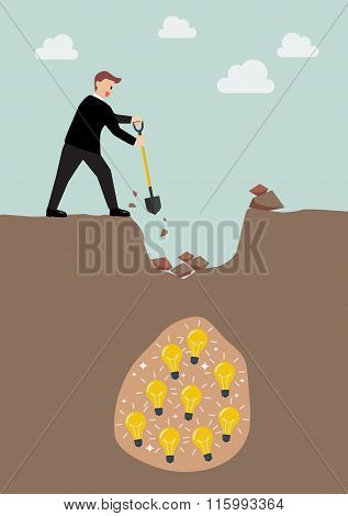 Businessman Digging A Ground To Find An Idea