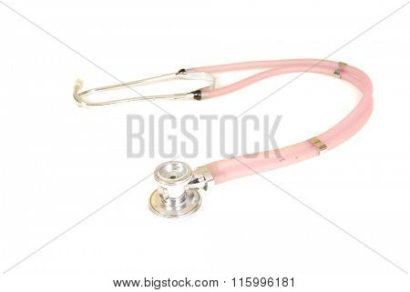 colorful pale pink Stethoscope laying on a white surface