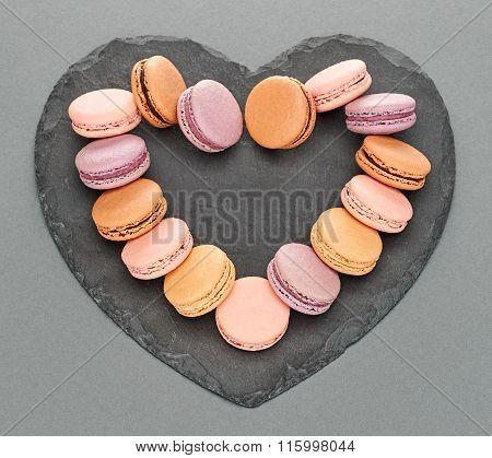 Still life, macarons, heart shape. Love concept