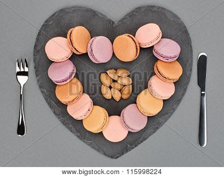 Still life, macarons, heart shape. Table setting