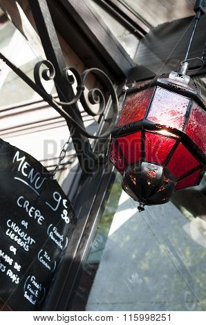 red lantern and menu sign outside a Parisian bistrot