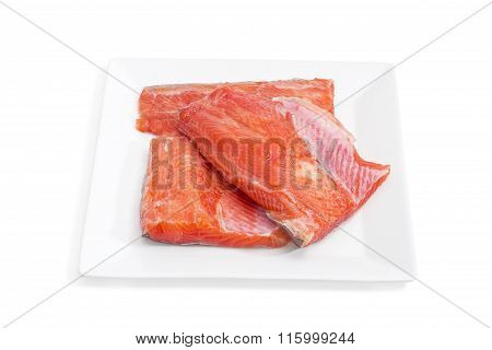 Uncooked Fillet Of Rainbow Trout On A Square Dish Closeup