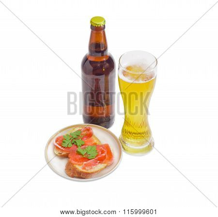 Lager Beer And Sandwiches With Salted Trout On Light Background