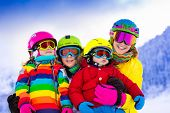 Постер, плакат: Family With Children On Winter Ski Vacation