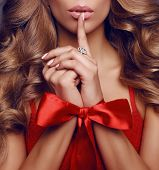 Beautiful Sexy Woman With Long Blond Curly Hair ,red Bow On Her Hands poster