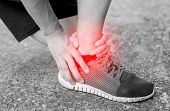 Постер, плакат: Runner Touching Painful Twisted Or Broken Ankle Athlete Runner Training Accident Sport Running Ank