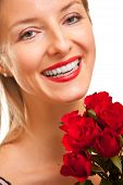 Beautiful caucasian woman with red roses on white isolated background