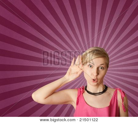 female overhearing something with her ear and hand, wery surprised