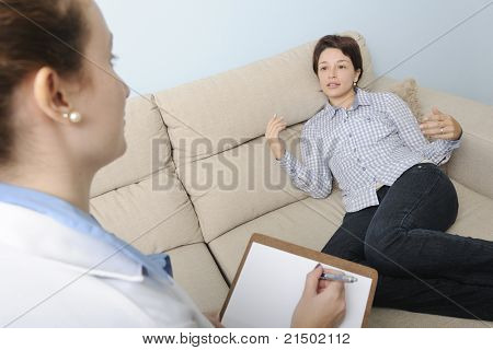 psychologist or psychiatrist listening to patient