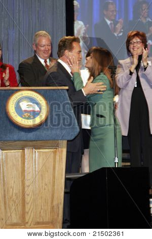 LONG BEACH - DEC 7: Arnold Schwarzenegger; Maria Shriver at the California Governor's Conference on Women and Families at the Convention Center on December 7, 2004 in Long Beach, California