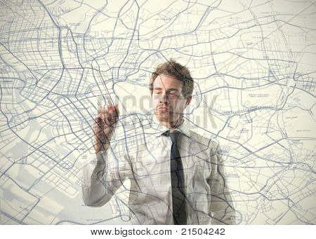 Young businessman drawing on a map