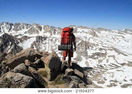 Backpacker On Mountain